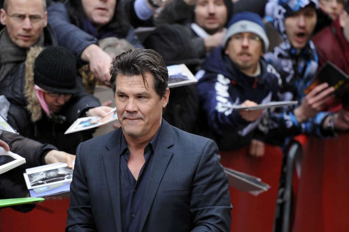 Actor Josh Brolin signing autographs on arrival for a photocall to promote the movie Hail, Caesar! at the 66th Berlinale International Film Festival in Berlin, Germany on Feb 11, 2016.