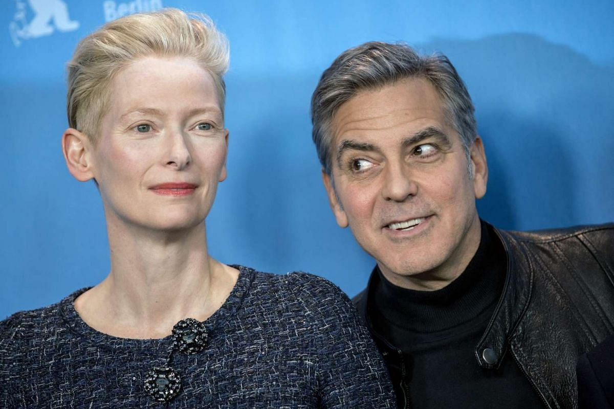 Tilda Swinton (left) and George Clooney pose during the photocall for Hail, Caesar! at the 66th annual Berlin International Film Festival, in Berlin, Germany on Feb 11, 2016.