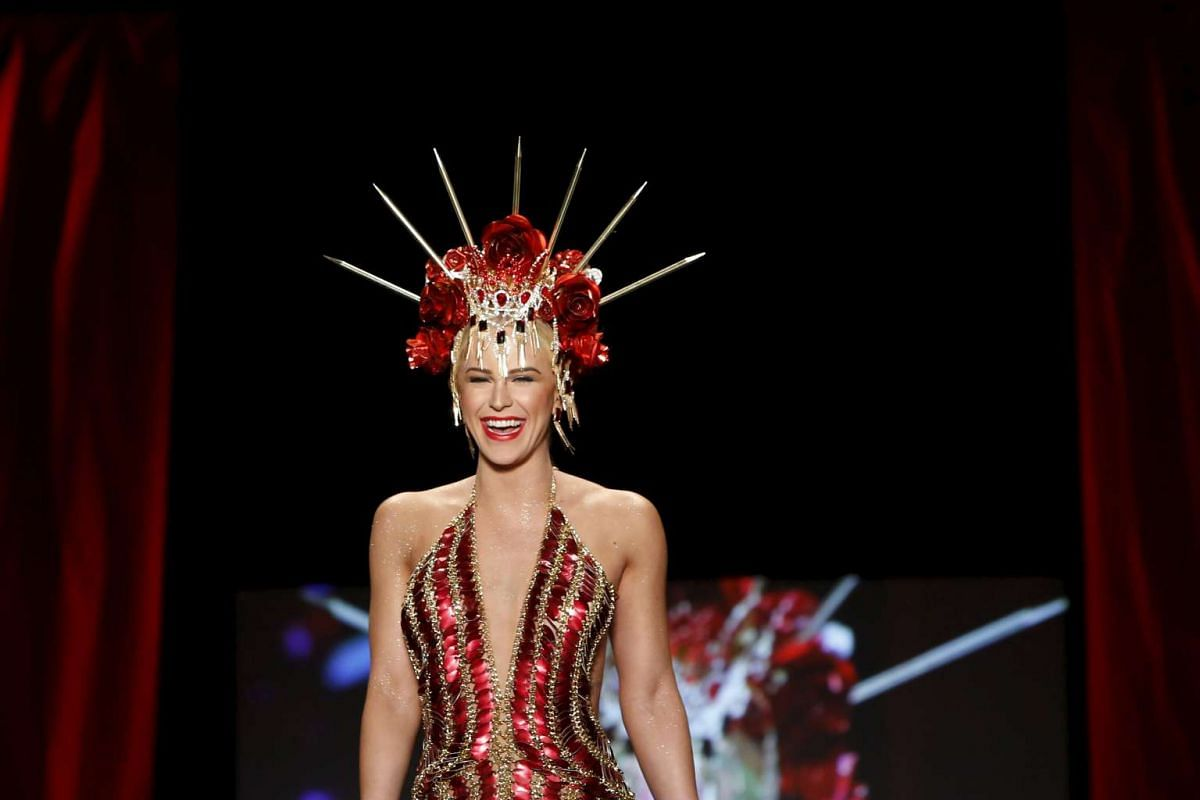 Gigi Gorgeous presenting a creation during the American Heart Association's (AHA) Go Red For Women Red Dress Collection, presented by Macy's at the New York Fashion Week on Feb 11, 2016.