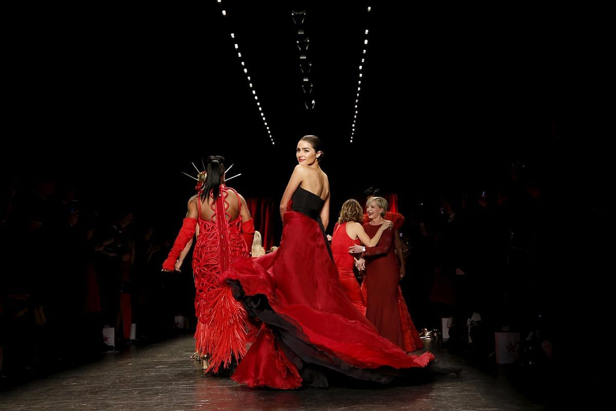 Olivia Culpo presenting a creation from the American Heart Association's Go Red For Women Red Dress Collection at the New York Fashion Week on Feb 11.