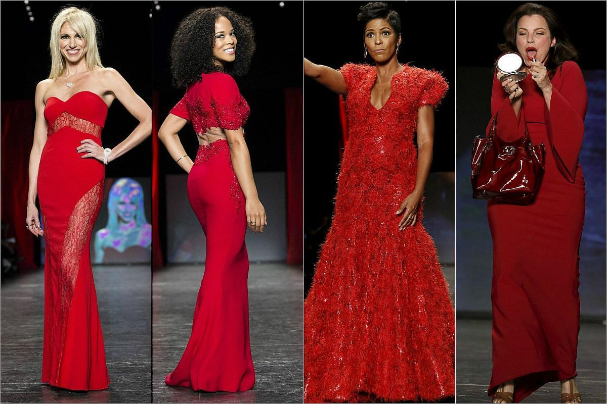 (From right) Fran Drescher, Tamron Hall and two models presenting the American Heart Association's Go Red For Women Red Dress Collection at the New York Fashion Week on Feb 11.