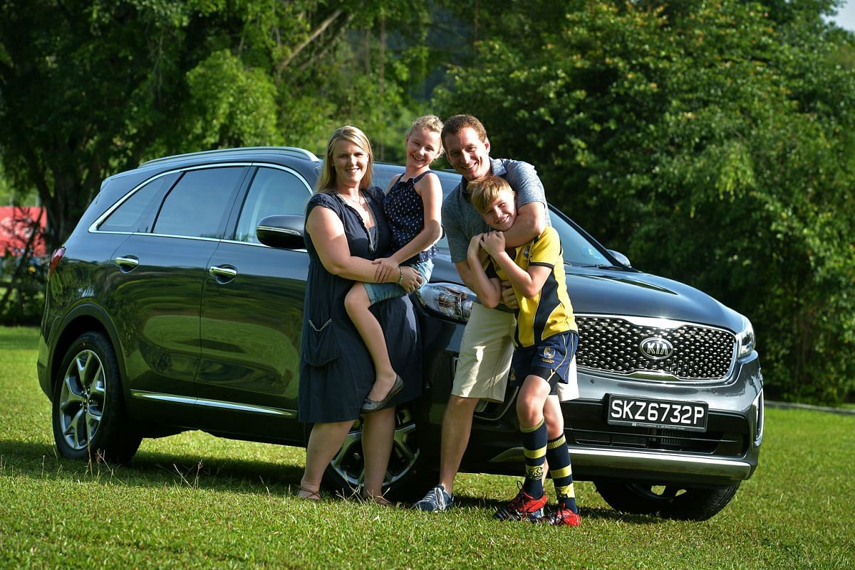 Mr Andrew Habgood (above), with his wife Michelle and their children Ally (above left) and Van (above right) bought the Kia Sorento.