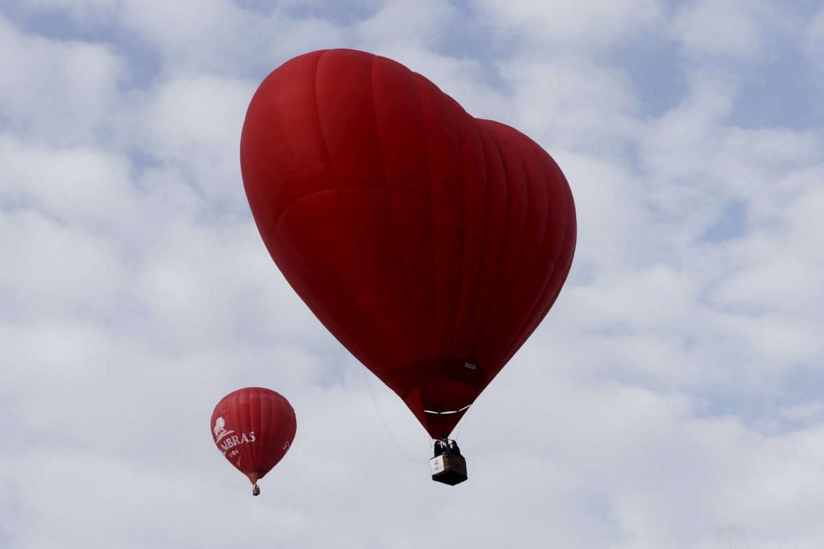 A heart-shaped hot air balloon flies in the sky during the Love Cup 2016 event, ahead of Valentine's Day, in Jekabpils, Latvia, on Feb 13, 2016.