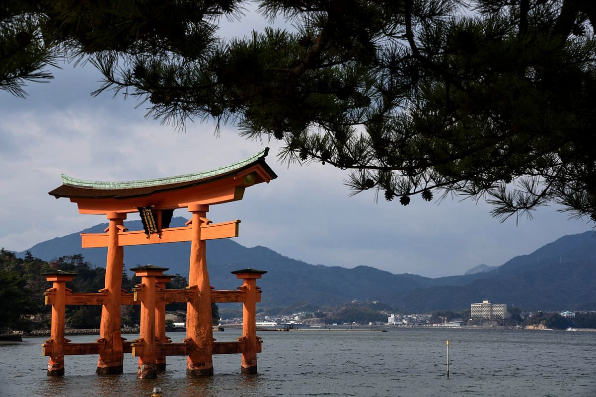 The iconic torii gate of Itsukushima Shrine stands in the inland sea during high tide.