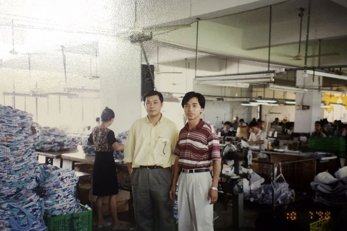 Mr Koh (left) with his operations manager at his factory in China in 1998, when he was running Pete's Creation. At the height of the business, the factory hired more than 600 people.