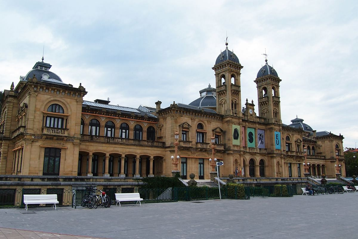 The San Sebastian City Hall is adorned with flags of the city's status as the European Capital of Culture 2016. The building was the city's Gran Casino from 1897 until the prohibition of gambling in 1924.