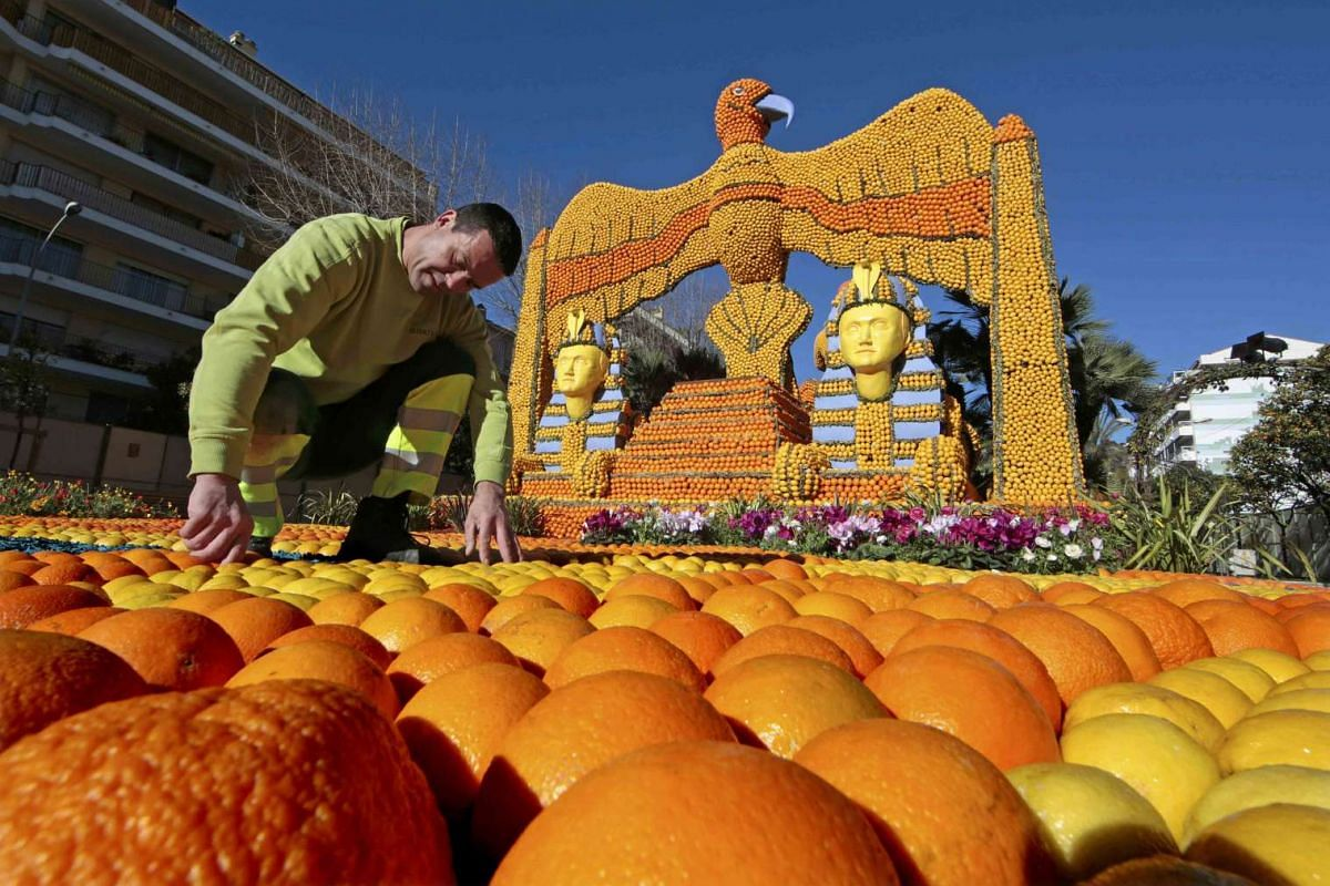 A worker puts the final touch to a giant pharaoh replica at the Lemon festival in Menton, France on Feb 10, 2016.