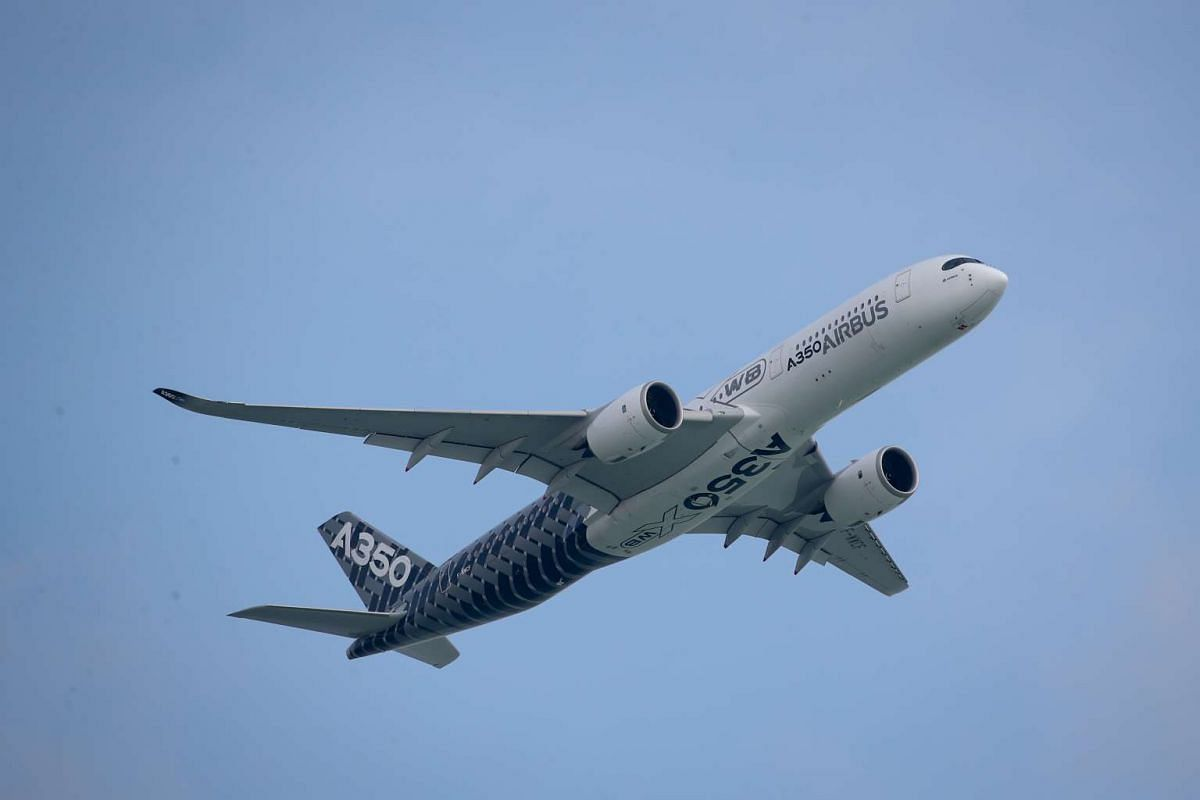 An aerial display of the A350 XWB by the Airbus Group at the Singapore Airshow 2016 on Feb 14, 2016.