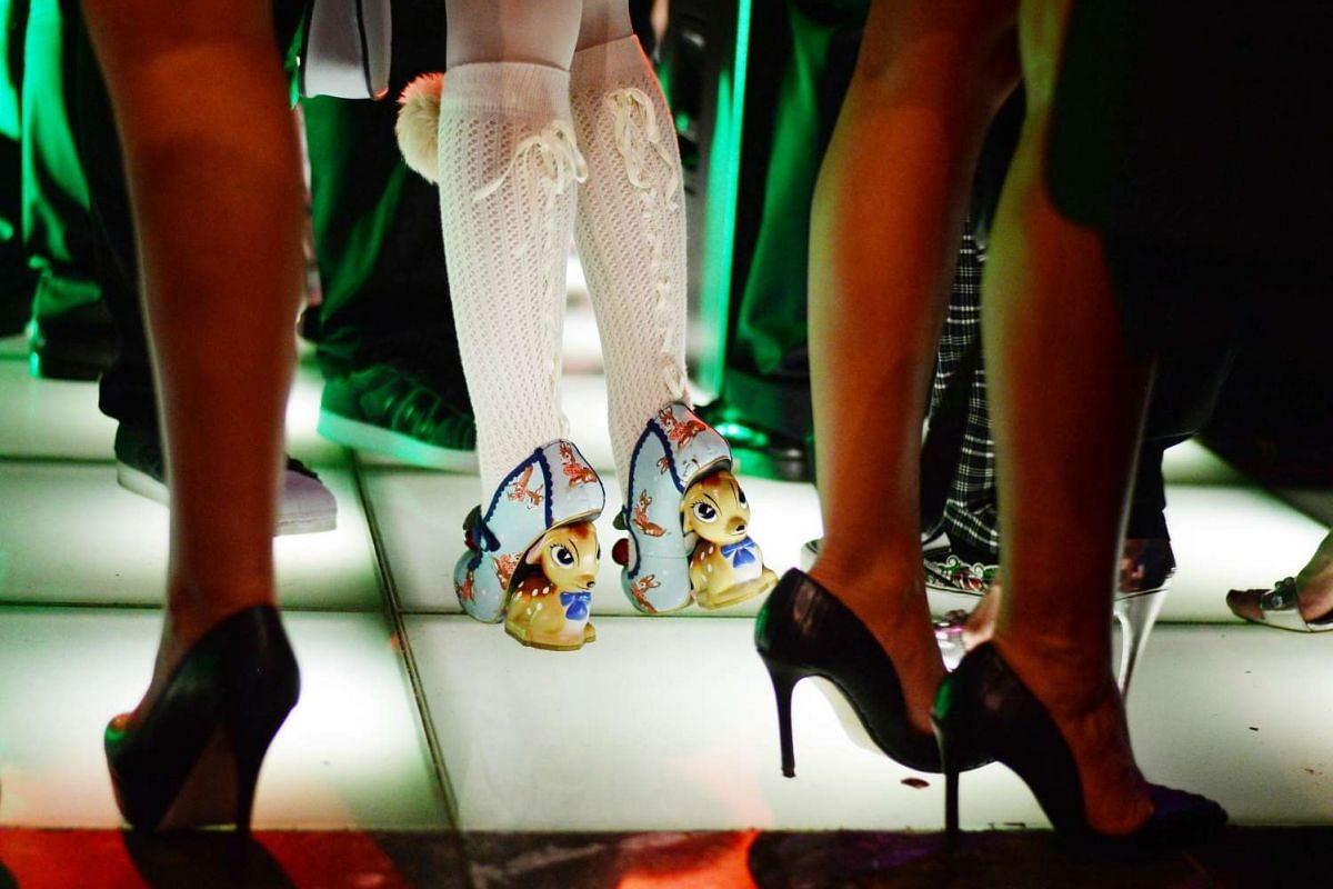 A guest wears high-heels featuring Bambi figures at the Lausbubenparty during the 66th annual Berlin International Film Festival, in Berlin, Germany on Feb 13, 2016.