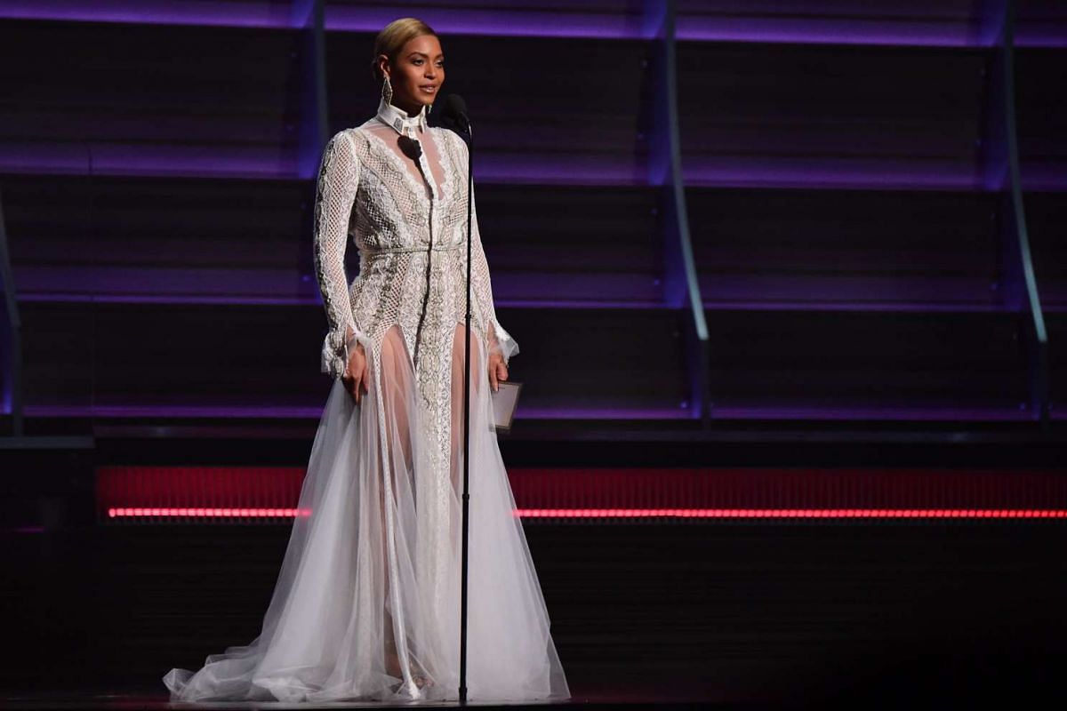 Beyonce speaking onstage during the 58th Annual Grammy music Awards.