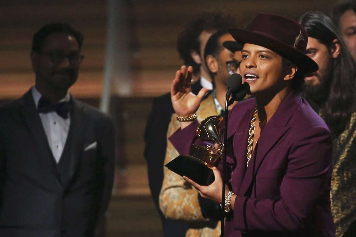 Singer Bruno Mars accepting the Best Record of the Year award during the 58th Grammy Awards.