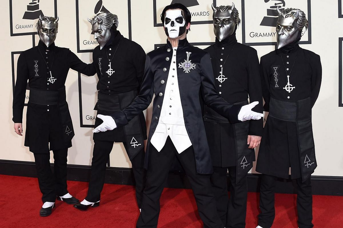 The members of Ghost arriving on the red carpet during the 58th Annual Grammy Music Awards.