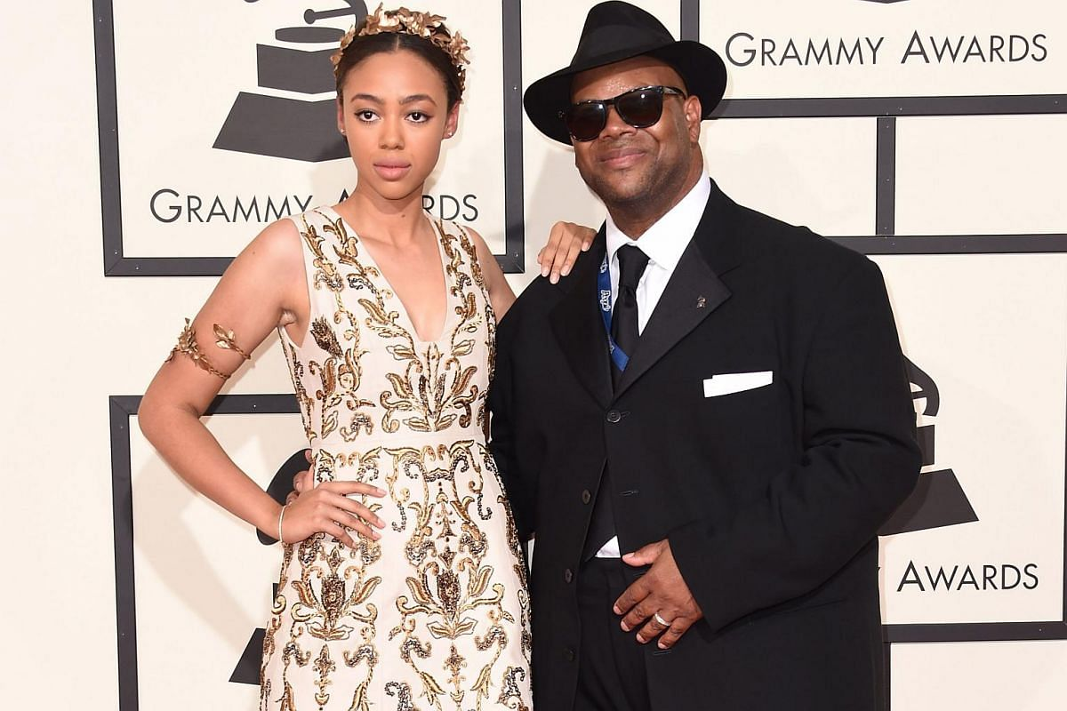 Jimmy Jam (right) and Bella Harris arriving on the red carpet during the 58th Annual Grammy Music Awards.