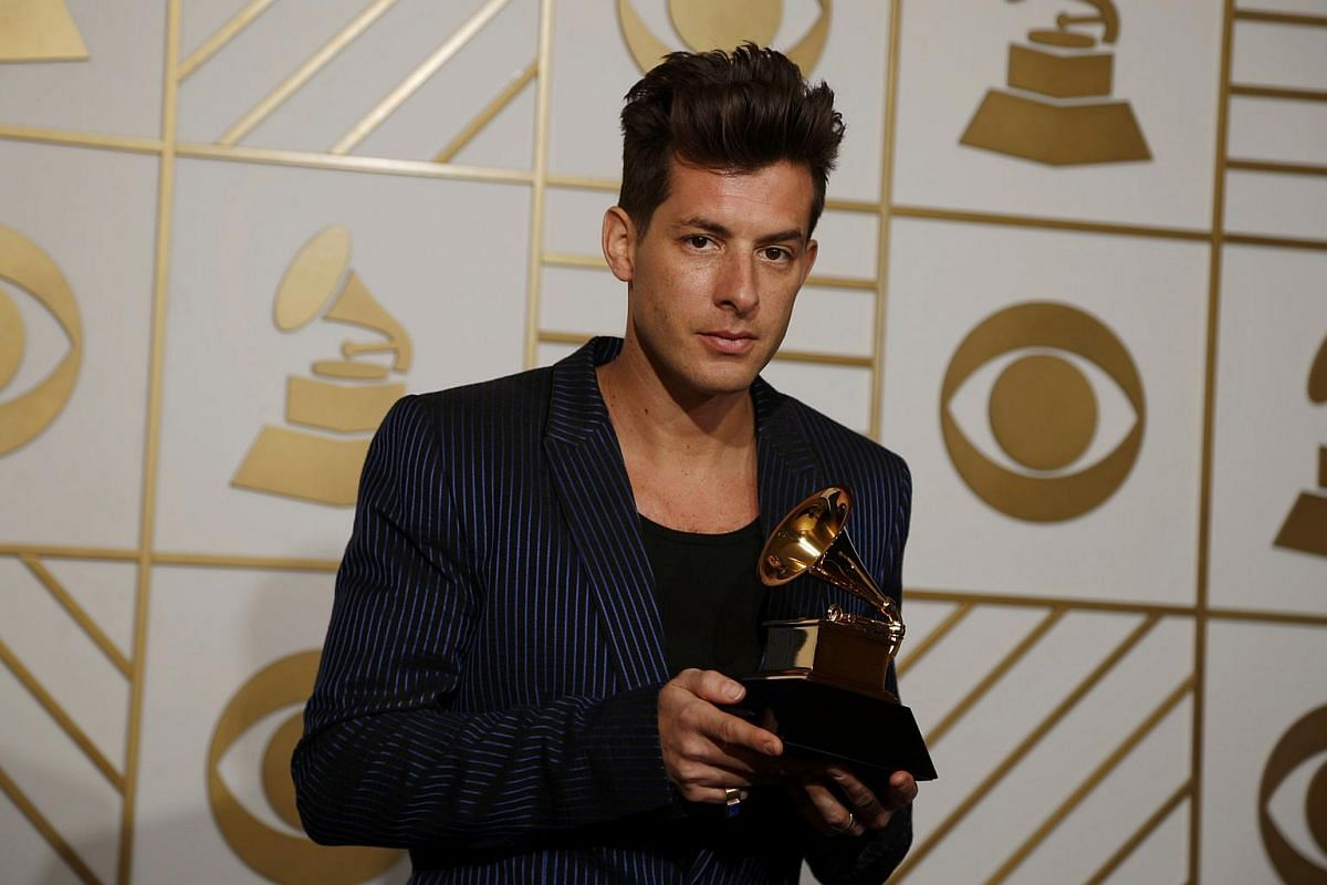 Mark Ronson posing with his award for Best Pop Duo/Group Performance for Uptown Funk backstage at the 58th Grammy Awards.