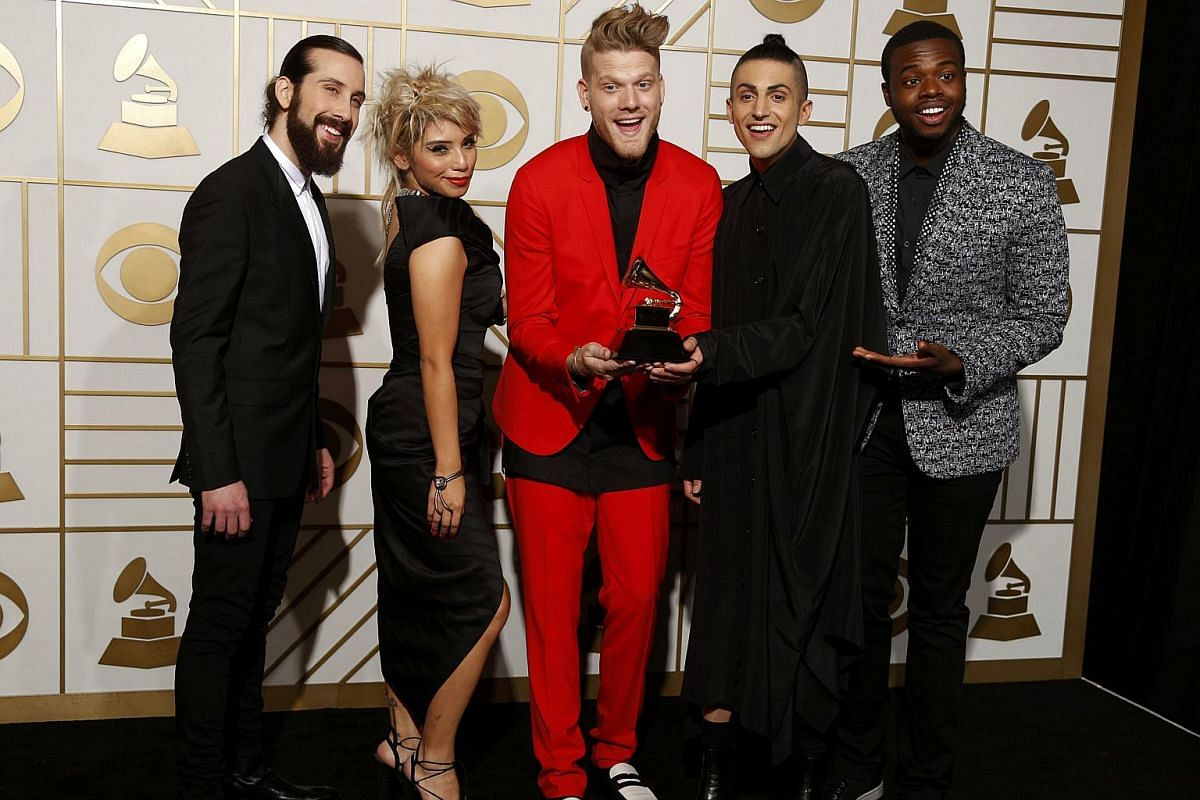 Pentatonix posing with their award for for Best Arrangement, Instumental or A Cappella, for Dance Of The Sugar Plum Fairy backstage at the 58th Grammy Awards.