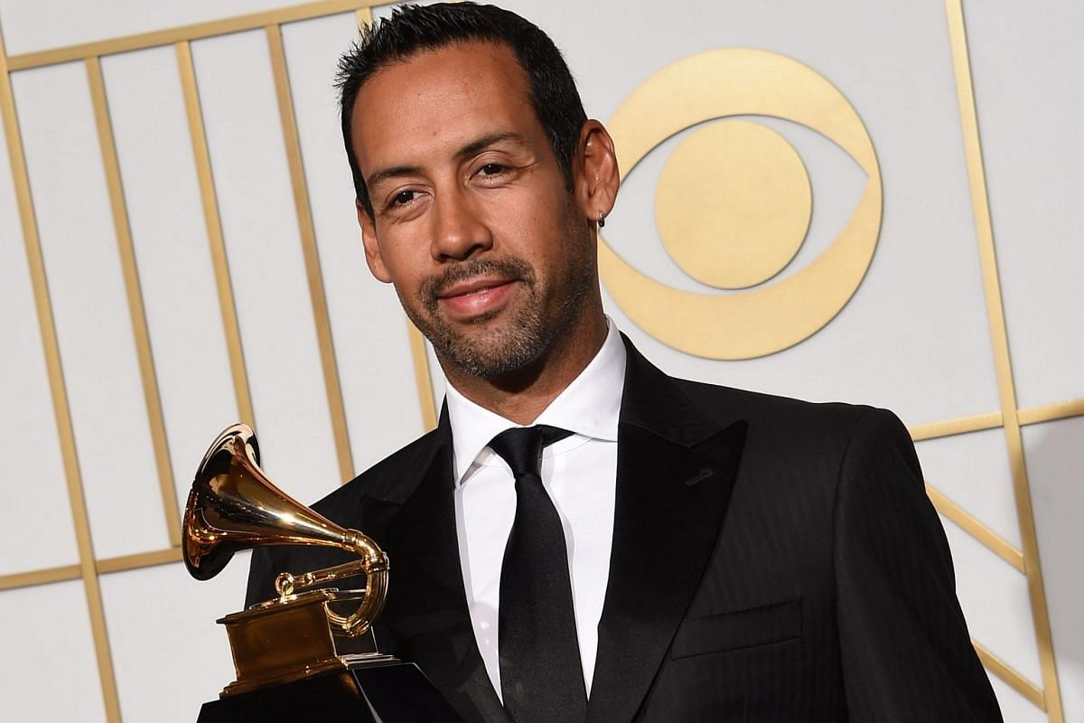 Composer Antonio Sanchez posing with his trophy for Best Score Soundtrack for Visual Media Birdman in the press room during the 58th Annual Grammy Music Awards.