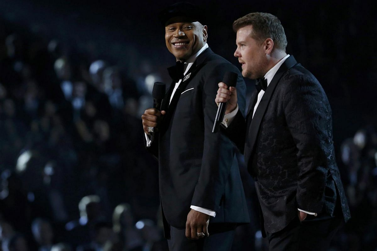 Host LL Cool J (left) and James Corden introducing a medley honouring Recording Academy Person of the Year Lionel Richie at the 58th Grammy Awards.