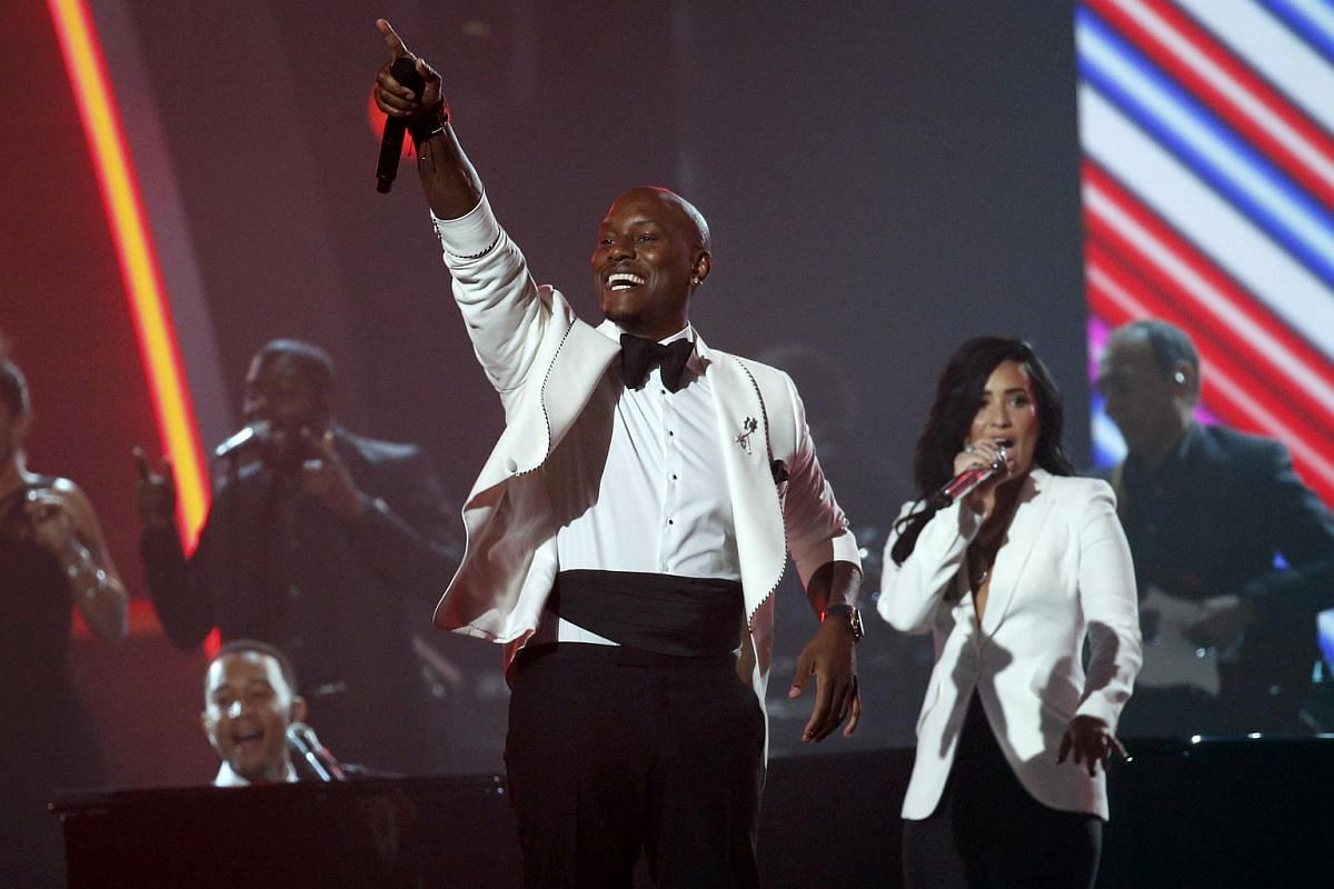 Tyrese performing Brick House as John Legend (left) and Demi Lovato sing along during a medley honouring Recording Academy Person of the Year Lionel Richie at the 58th Grammy Awards.