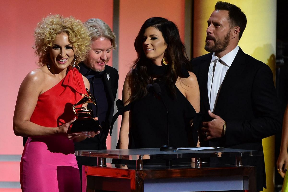 Members of Little Big Town receiving the award for the Best Country Duo/Group Performance, Girl Crush, onstage during the 58th Annual Grammy music Awards.