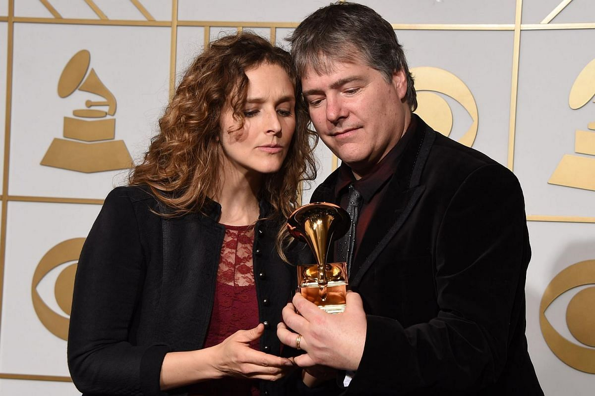 Bela Fleck and Abigail Washburn posing with the trophy for Best Folk Album in the press room during the 58th Annual Grammy Music Awards.