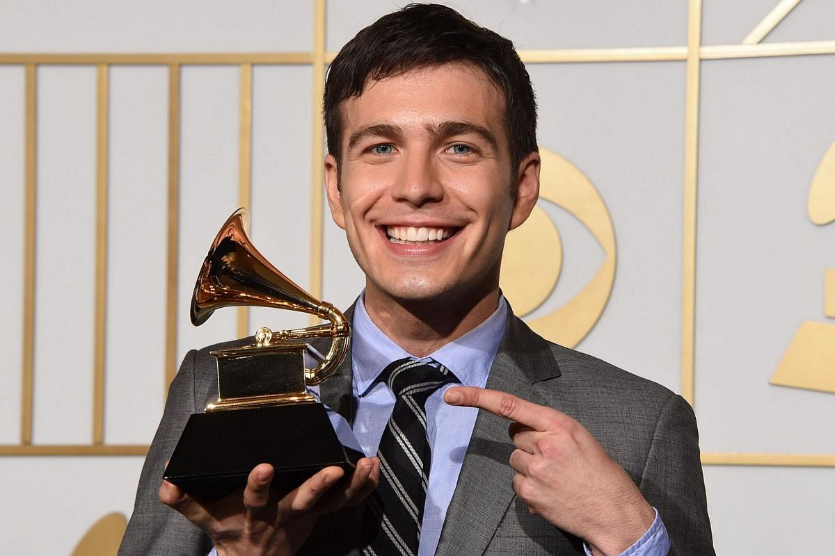 Tim Kubart posing with the trophy for Best Children's Album Home in the press room during the 58th Annual Grammy Music Awards.