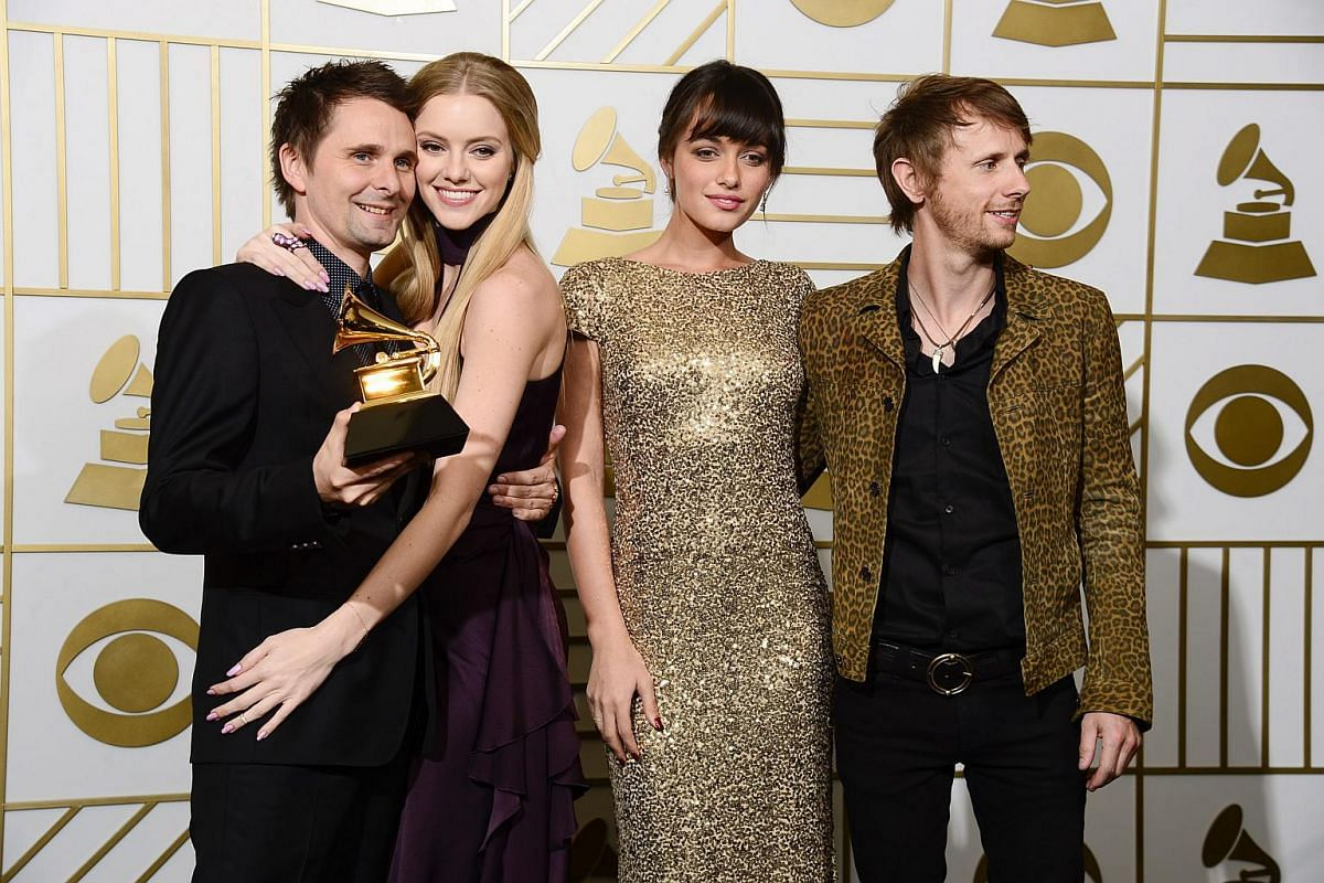Muse holding up their award for Best Rock Album for Drones in the press room during the 58th annual Grammy Awards ceremony.