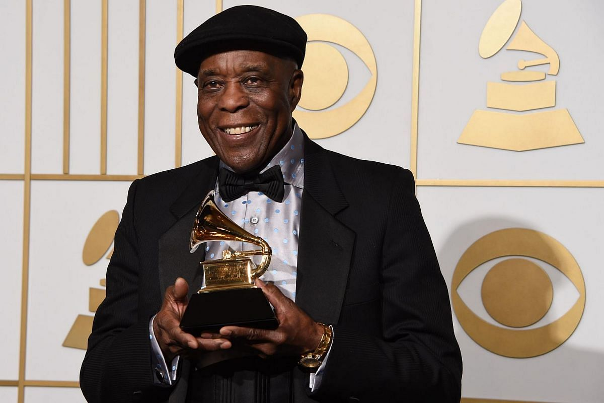 Buddy Guy holding his trophy for Best Blues Album titled Born To Play Guitar in the press room during the 58th Annual Grammy Music Awards.
