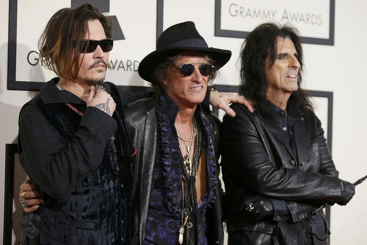 The Hollywood Vampires, (from left) Johnny Depp, Joe Perry and Alice Cooper, arriving at the 58th Grammy Awards in Los Angeles, California, on Feb 15, 2016.