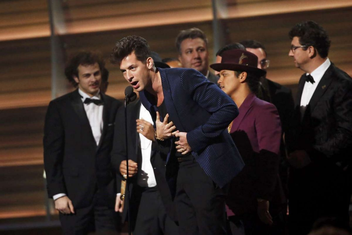 Musician Mark Ronson accepting the Best Record of the Year award during the 58th Grammy Awards.