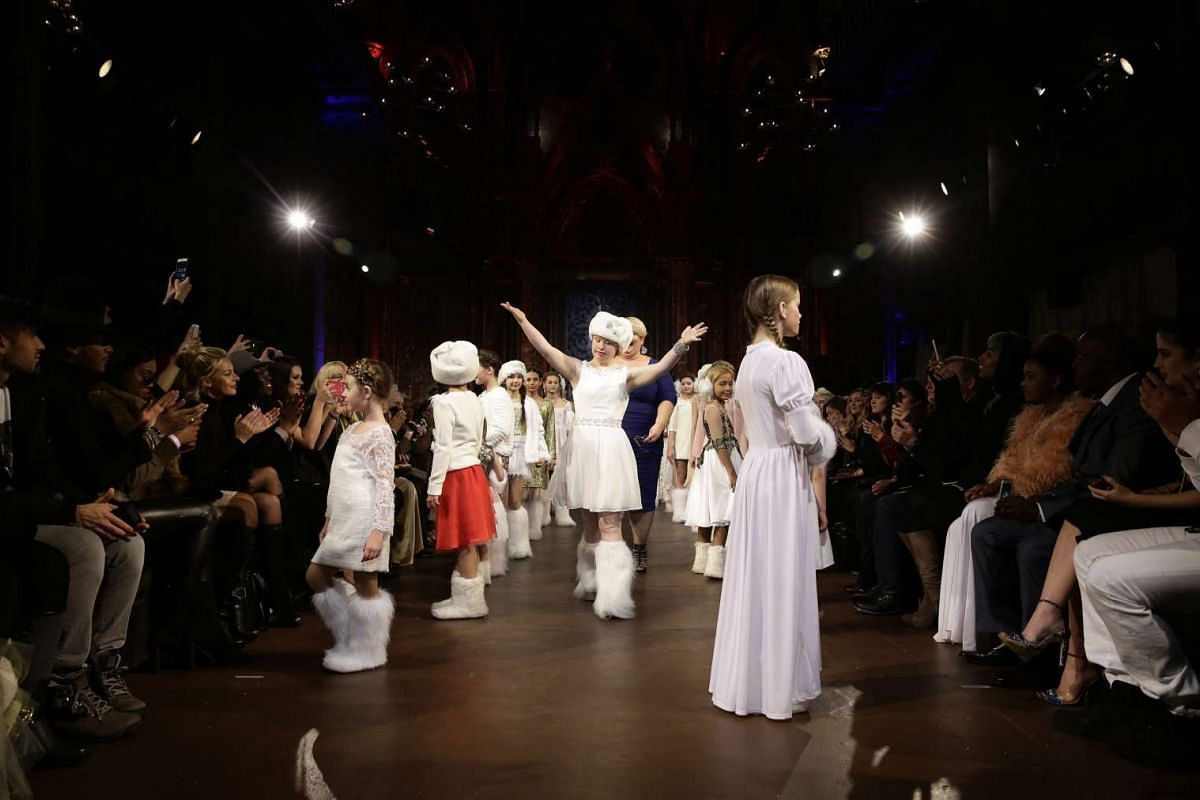 Australian model Madeline Stuart (centre), who has Down Syndrome, presenting creations with other young models from the Fall 2016 collection by FTL Moda during the New York Fall Fashion Week.