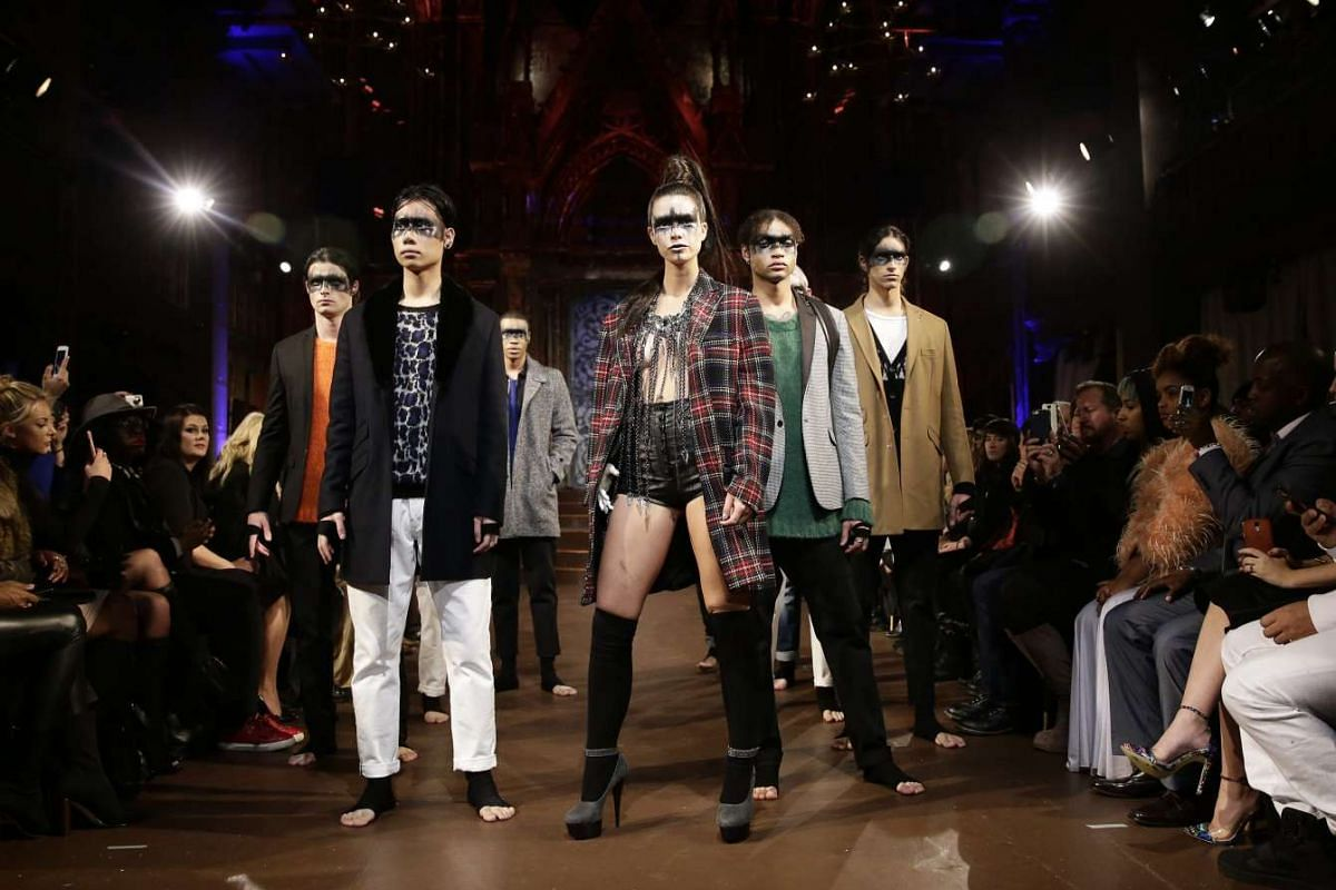 US amputee model Shaholly Ayers (centre) presenting a creation from the Fall 2016 collection by FTL Moda with other models during the New York Fall Fashion Week.