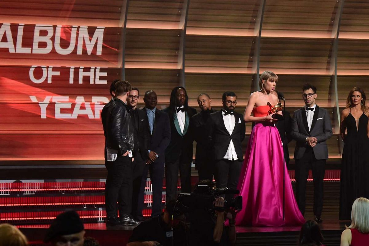 Singer Taylor Swift accepting the award for the Album of the Year onstage during the 58th Annual Grammy music Awards.