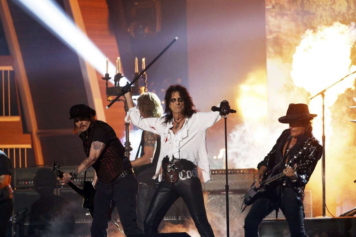 (From left) Johnny Depp, Duff McKagan, Alice Cooper and Joe Perry of the band Hollywood Vampires perform As Bad As I Am during the 58th Grammy Awards.