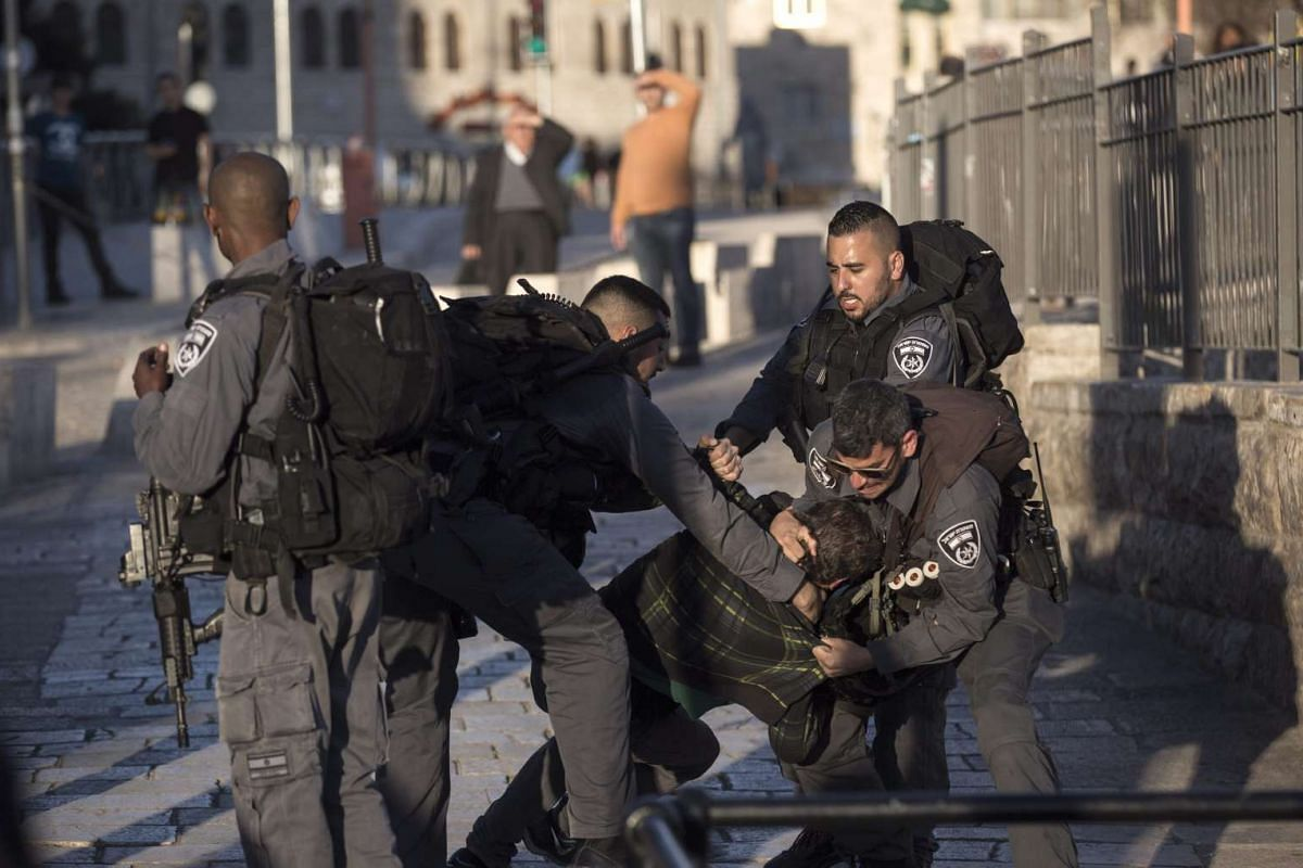 Israeli anti-riot police detains a suspected Palestinian man next to the Damascus Gate of the Old City district of Jerusalem, Feb 16, 2016. PHOTO: EPA/ATEF SAFADI