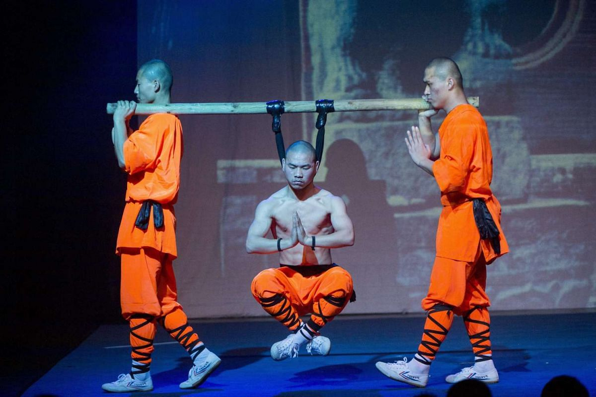 Shaolin Monks perform during their 'Shaolin Warriors – The Magical Secret' show at the MOM Culture Center in Budapest, Hungary, Feb 16, 2016. PHOTO: EPA/TIBOR ILLYES