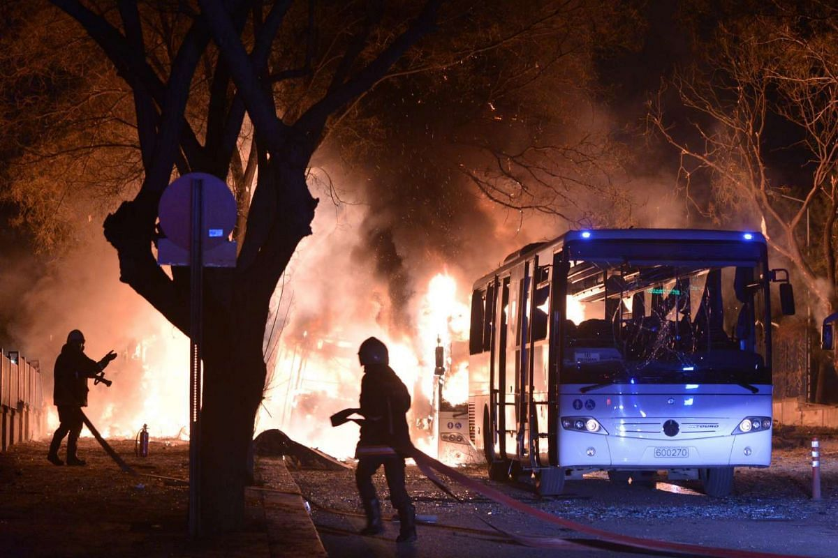 Firefighters try to extinguish the flames at the scene of a car bomb detonation close to buildings of the Turkish military, in Ankara, capital of Turkey, Feb 17, 2016. PHOTO: EPA/STRINGER