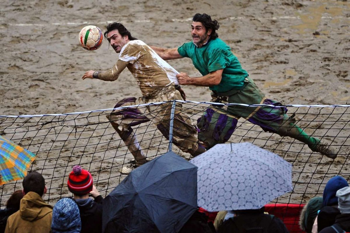 Players participate in a game of the Calcio Storico Fiorentino or traditional soccer played in costume at the Santa Croce Square in Florence, Italy, on Feb 17, 2016. PHOTO: EPA/MAURIZIO DEGL' INNOCENTI
