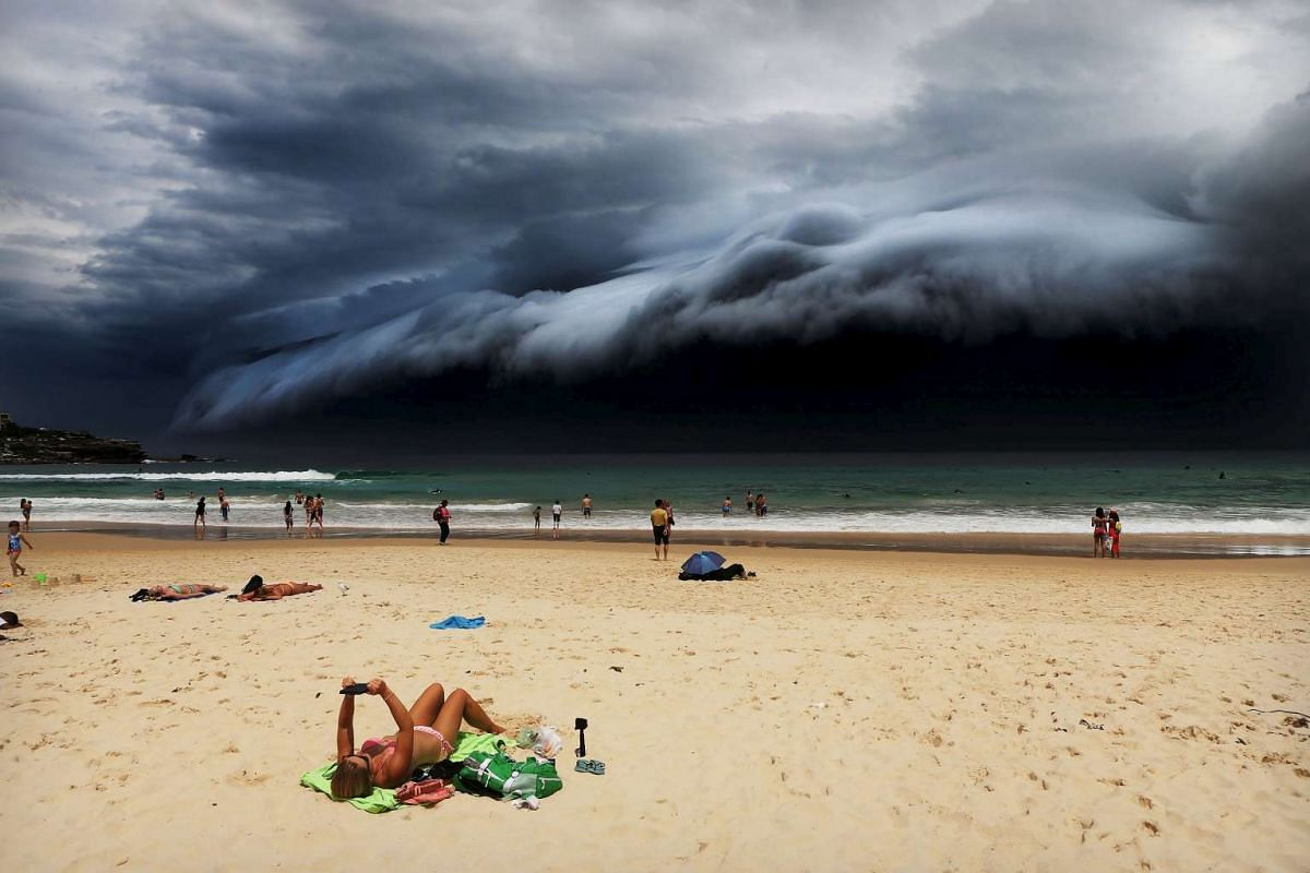 Rohan Kelly's Storm Front On Bondi Beach won first prize singles in the Nature category at the World Press Photo Awards. The photo shows a massive cloud tsunami looming over Sydney, an event seen only a few times a year.