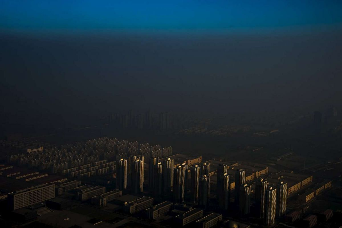Zhang Lei's Haze In China won first prize singles in the Contemporary Issues category at the World Press Photo Awards. The photo shows a city in northern China shrouded in haze, taken on Dec 10, 2015.