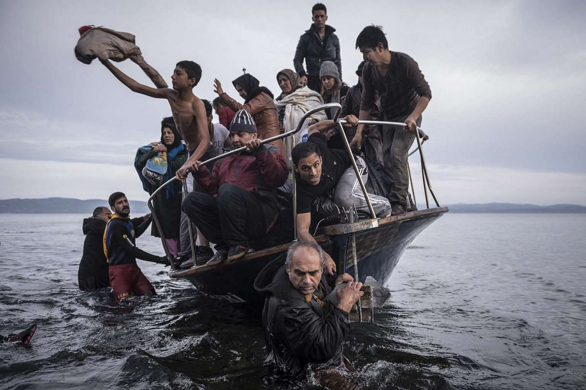 Russian photographer Sergey Ponomarev's photos won first prize for the Stories in the General News category at the 59th annual World Press Photo Contest. This photo shows migrants and refugees arriving by boat on the Greek island of Lesbos on Nov 15,