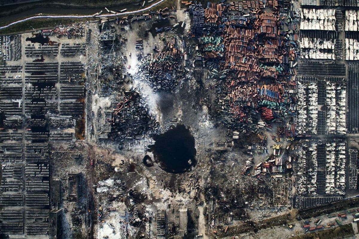 Chinese photographer Chen Jie won third prize singles in the General News category of the 59th annual World Press Photo Contest. This photo shows an aerial view of the destruction after the explosion in Tianjin, China on Aug 15, 2015.