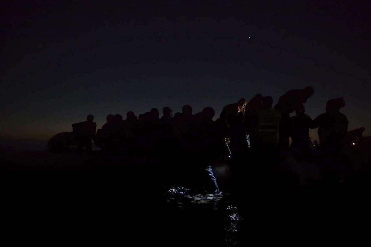Swedish photographer Paul Hansen won second prize in the General News category of the 59th annual World Press Photo Contest. This photo shows refugees traveling in darkness through Europe to avoid detection, taken in Lesbos, Greece on Dec 6, 2015.