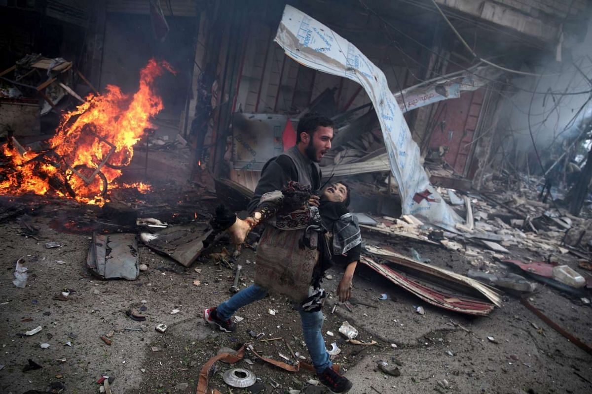 Abd Doumany's photos won Second Prize Stories in the General News category at the 59th annual World Press Photo Contest. This photo shows a Syrian man carrying the body of a child killed in a reported air strike by government forces in the rebel-held