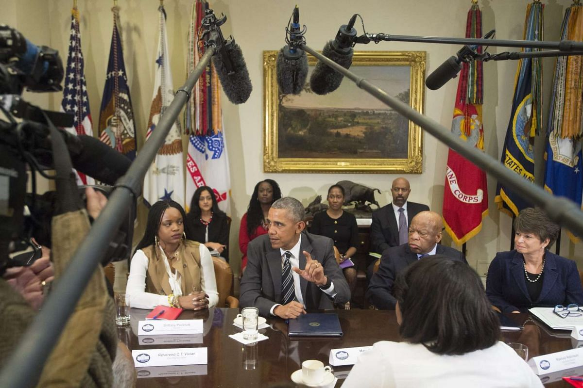 US President Barack Obama (C) meets with African American faith and civil rights leaders and members of his administration, in the Roosevelt Room of the White House, in Washington, DC, Feb 18, 2016. PHOTO: EPA/MICHAEL REYNOLDS