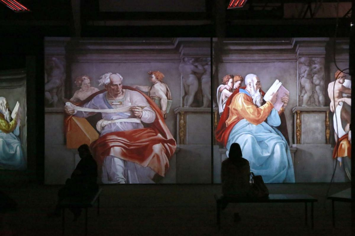 Visitors look at the large-scale multimedia exhibition Michelangelo: The Creation in the gallery ZEH in Minsk, Belarus, Feb 18, 2016. PHOTO: EPA/TATYANA ZENKOVICH