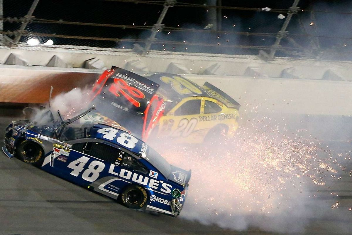 Jimmie Johnson, of Lowe's Chevrolet, Martin Truex Jr, of Bass Pro Shops/Tracker Boats Toyota, and Matt Kenseth, of Dollar General Toyota, have an on track incident during the NASCAR Sprint Cup Series Can-Am Duels at Daytona International Speedway on