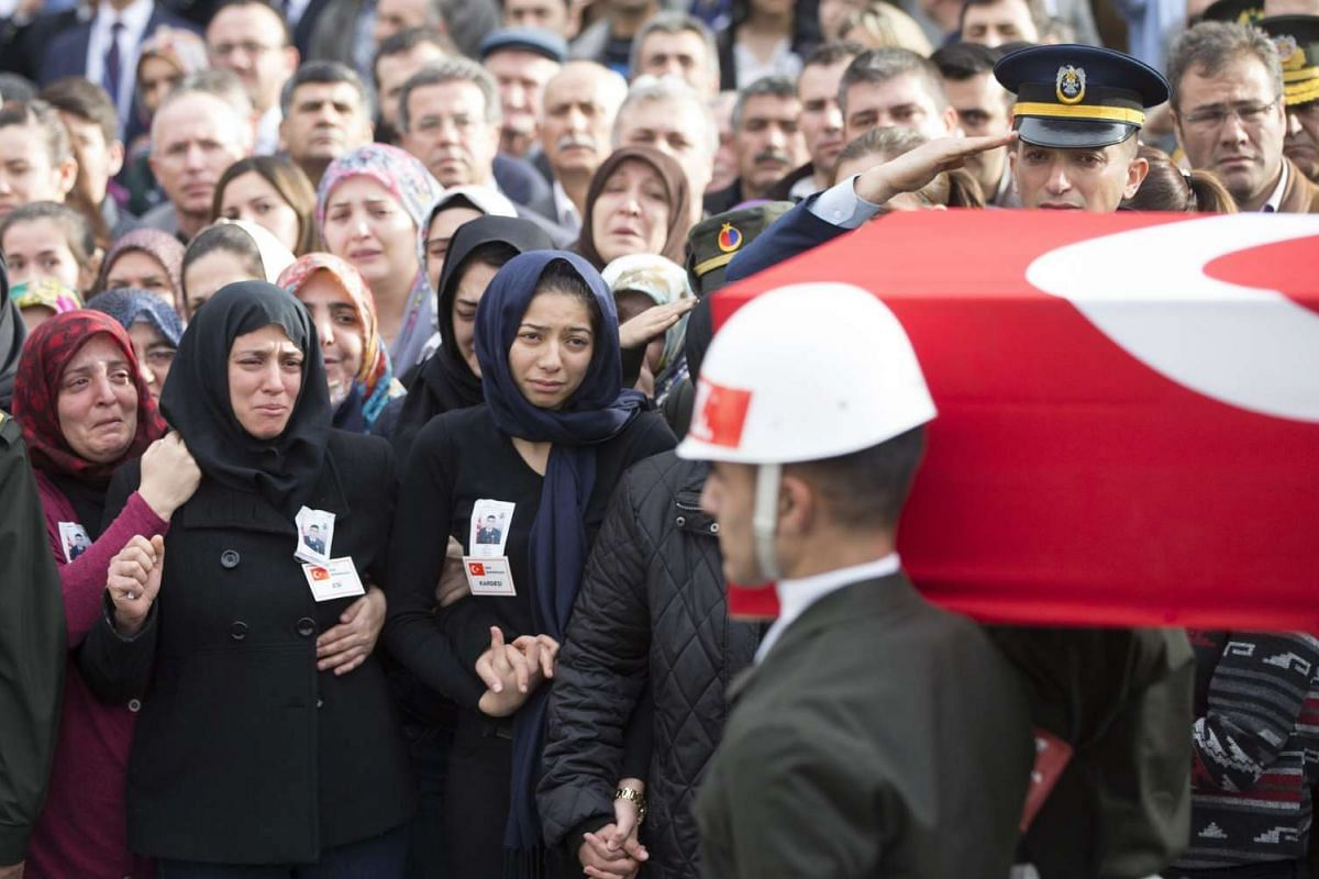 Relatives of Turkish soldier Seckin Cil killed by PKK during armed clashes on Feb 17 during a funeral in Ankara, Turkey, Feb 18, 2016. PHOTO: EPA/TOLGA BOZOGLU
