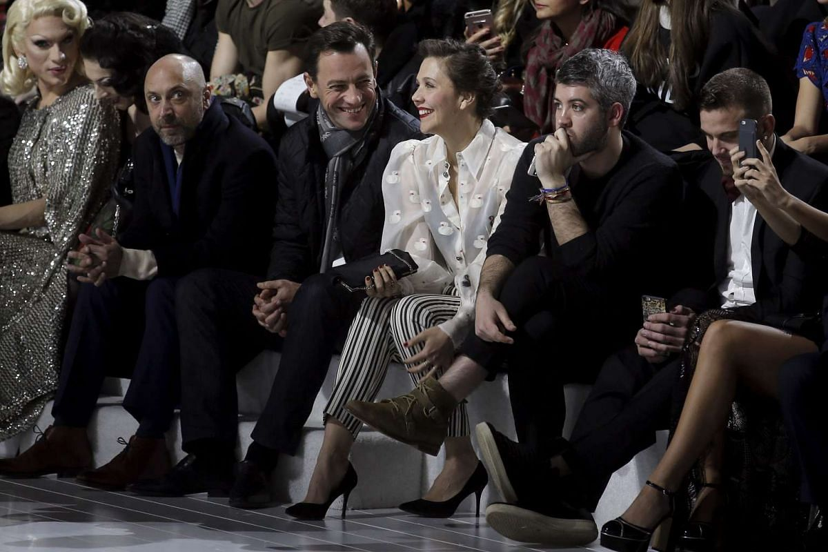 Actress Maggie Gyllenhaal (centre) sits before the Marc Jacobs at the New York Fashion Week, on Feb 18, 2016.