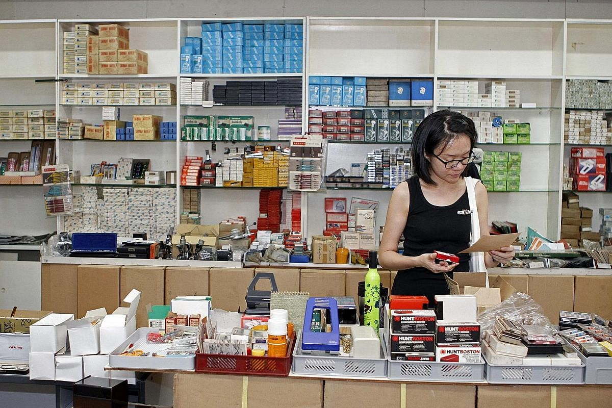 Vintage items which are on sale include (clockwise from top) ink erasers (50 cents each), fingerprint ink sets ($4 each) and a telephone index ($5). The late Mr Kwok Tien Pui started Kaiming Enterprises in 1939 in a shophouse in Cross Street. Ms Tan