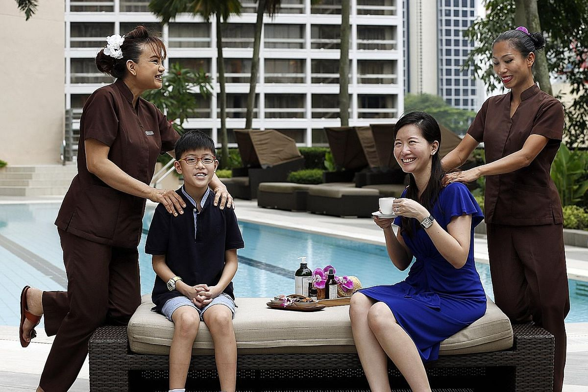 Sarah Tan, eight, celebrated her birthday last year with a spa party package that included manicures, pedicures, and face and body paint. Housewife Miko Ong and her son Iain (both above), nine, having a massage at Four Seasons hotel. Restaurant group